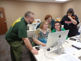 (L-R) Lions Brian Geffre, Gayle Hyde, Denise Johnson, Yvonne Kalka, and Terri Egan check tabulations before finals.