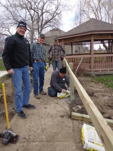 Lions worked together to place posts and guard rails on a walkway for visitors and those being trained.