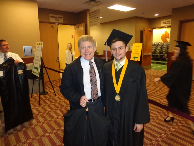 Campus club advisor Lion Robert and NDSU Club President Shane celebrate graduation!