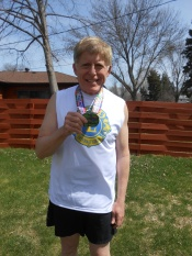 Robert after the half marathon with his medal.