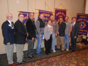 Seven new Lions join the ranks of service at 20-O luncheon.