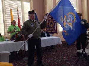 The North Dakota flag is presented
