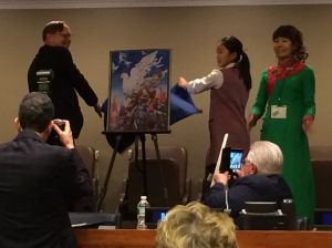 President Preston helps to unveil the winning peace poster.