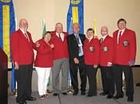 DGEs (L-R): Jerry Voss (SE), Judy Beaudry (NW), Chuck Edwards (SW), VDG Trainer PDG Leo Grossman, DGE Eunice Cameron (SKS), Garry Jopko (SKN), and Rick Swenson (NE).