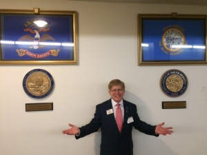 ID Robert finds the state flags and seals for North Dakota and South Dakota in an underground walkway between office buildings.