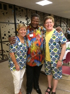 Lion Kathy and ID Robert wearing clothing made from fabric created by ID Alexis Gomes from Republic of the Congo who chaired the 2014-15 PR Committee.