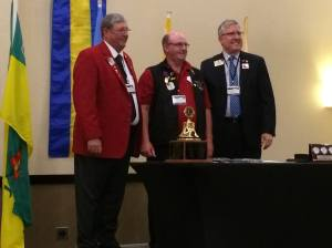 PCC Dennis (middle) receives the Leadership Medal from ID Larry Dicus representing International President Joe Preston.