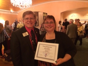 """ID Robert and Lion Shelly Wiggins from Saskatchewan celebrate her accomplishment--a """"masters"""" in district Lions leadership."""