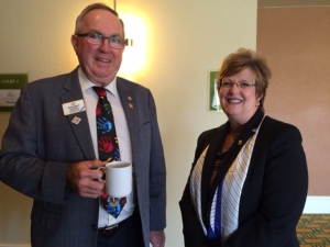 PID Marvin Chambers from Filmore, Saskatchewan and Lion Dianne Corlew enjoy an opportunity to catch up.