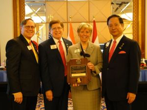LCIF Chair Preston and LCI President Yamada present Lion Kathy with a Melvin Jones Fellowship.