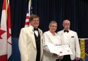 Pictured here is ID Robert, PDG Ellie Mae, and DG Garry at the banquet.
